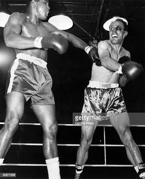American boxer Cassius Clay fighting Henry Cooper at Wembley