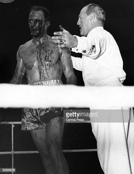Henry Cooper the British heavyweight champion is told in the fifth round that his world title fight against Cassius Clay is over after heavy bleeding...