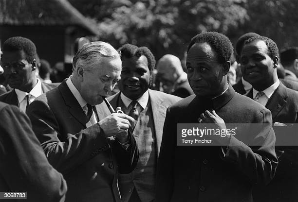 Lighting his pipe British Prime Minister Harold Wilson and on the right Dr Kwame Nkrumah Prime Minister of Ghana at a Commonwealth Prime Ministers...