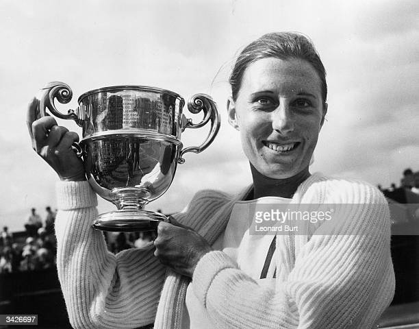 French tennis player Francoise Durr with the women's singles trophy after beating Jan Tegart of Australia in the final of the London Grass Court...