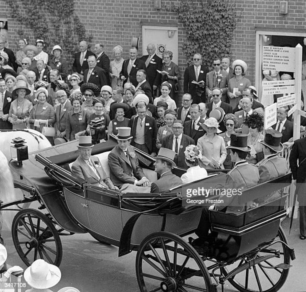 Queen Elizabeth II the Duke of Edinburgh and the Prince of Wales arriving in their open carriage on the first day of the Royal Ascot race meeting