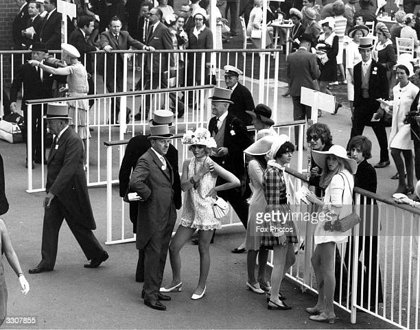 Racegoers in the enclosure on the first day of the Royal Ascot race meeting In the centre is showjumper and debutante Jayne Harries wearing a...