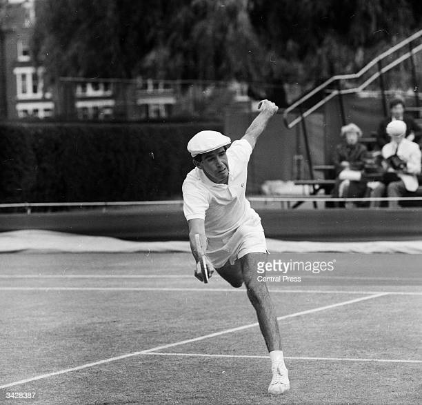 South African tennis player F D McMillan in a singles match against Dennis Ralston during the London Grass Courts Championships at the Queens Club...