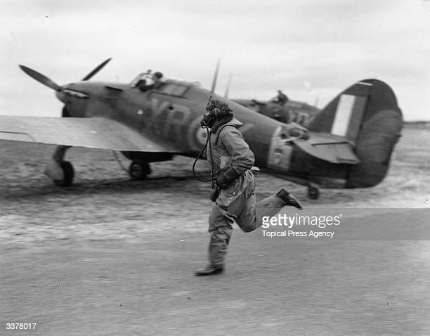 A member of the American 'Eagle' Volunteer Air Squadron runs to his Hurricane during an alarm
