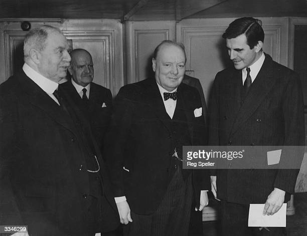 Prime Minister Winston Churchill and American Ambassador Mr Winnant attend the annual Pilgrim's Club luncheon at the Savoy Hotel.