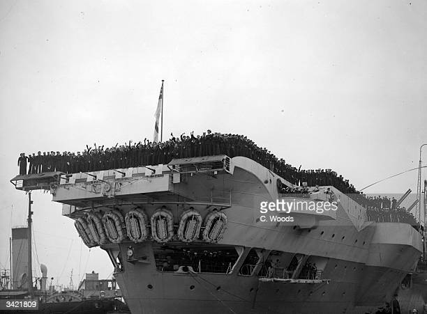 HMS Indefatigable arriving in England with its crew