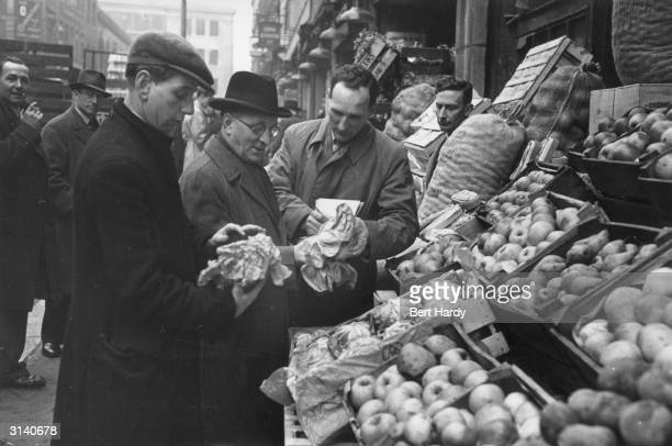 A fruit and vegetable stall at Covent Garden Market London Original Publication Picture Post 4993 Spring Comes To Covent Garden pub 1950