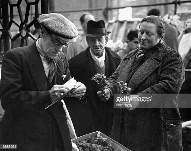 Market traders doing a deal at Covent Garden Market London Original Publication Picture Post 4993 Spring Comes To Covent Garden pub 1950