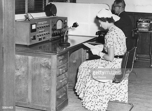 Queen Elizabeth II broadcasting from a Flying Doctor base at Broken Hill, New South Wales during a Royal tour of Australia.