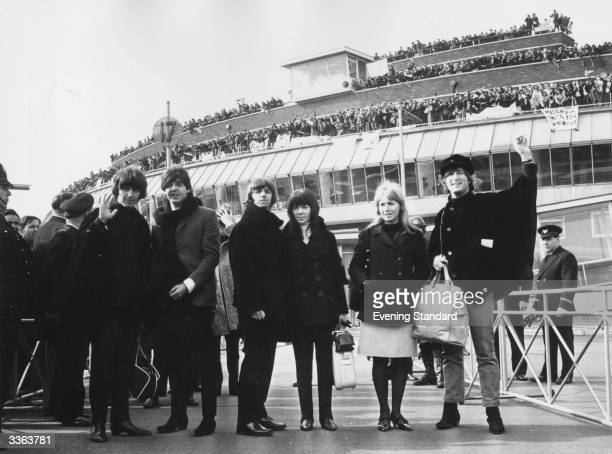 The Beatles bid farewell to their fans at London Airport George Harrison Paul McCartney Ringo Starr and John Lennon with their respective wives...