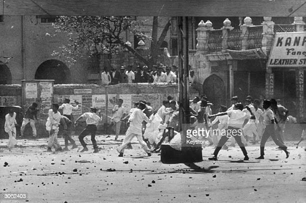 Stone throwing by a mob in Chandni Chowk shopping centre Old Delhi during riots between Hindus and Sikhs over the future of Punjab State