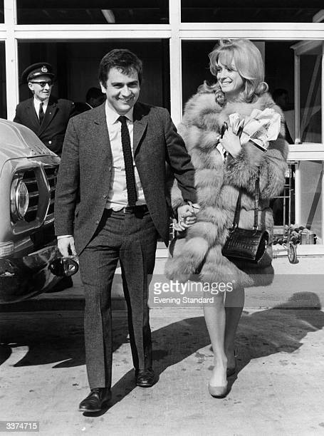 The comedian Dudley Moore and actress Suzy Kendall at Heathrow Airport London