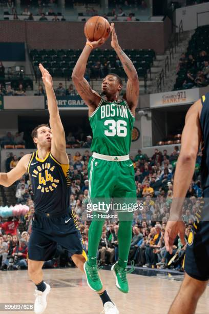 Marcus Smart of the Boston Celtics shoots the ball against the Indiana Pacers on December 18 2017 at Bankers Life Fieldhouse in Indianapolis Indiana...