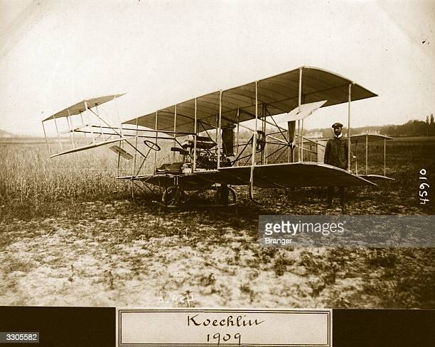 A Koechlin biplane in a field Aeroplan Album Vol 2 Page 94
