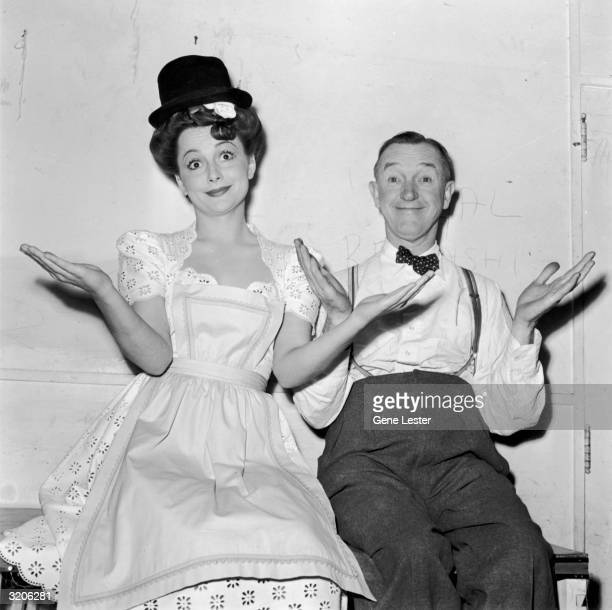 EXCLUSIVE Japaneseborn actor Olivia de Havilland and Britishborn comedic actor Stan Laurel shrugging while sitting backstage at the Hollywood Victory...