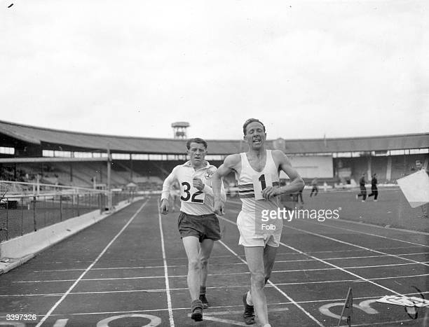 C Colman winning the 7 mile walk passing A H Poole at the British Games C A V Championships at White City Shepherds Bush London