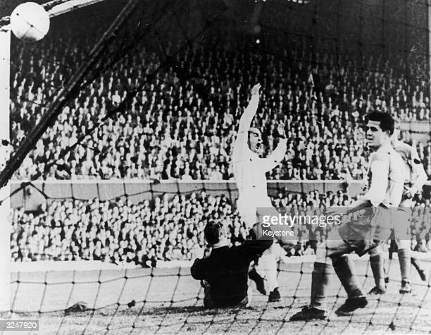 Alfredo Di Stefano of Real Madrid scores his team's second goal during the European Cup Final against Eintracht at Hampden Park Glasgow Real Madrid...