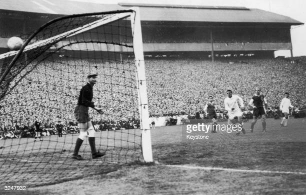 Loy the Eintracht goal keeper can only watch as Ferenc Puskas of Real Madrid scores his team's sixth goal during the European Cup Final against...