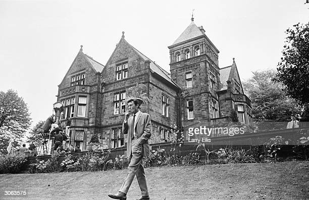 Lithuanianborn actor Laurence Harvey takes a stroll during the location filming of 'Life at the Top'