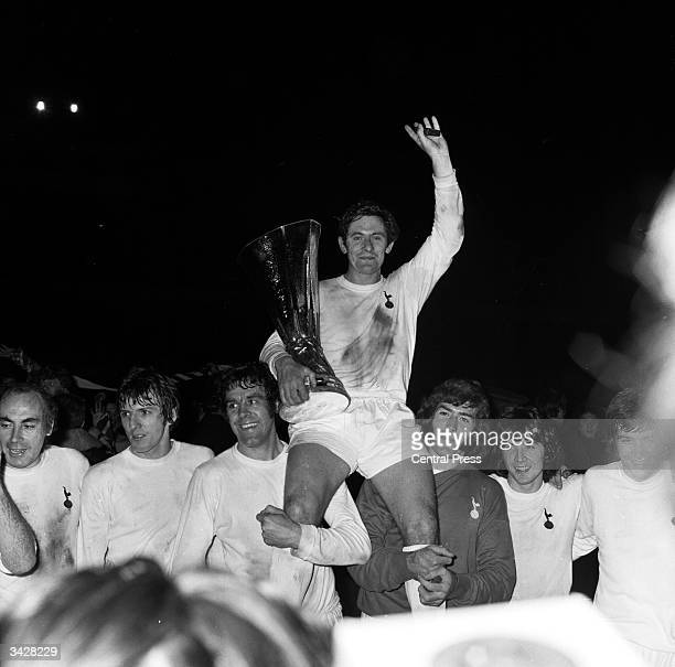 Tottenham Hotspur captain Alan Mullery holds the UEFA Cup trophy after his team beat Wolverhampton Wanderers 32 on aggregate after the second leg of...