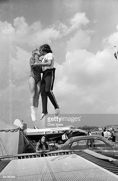 World trampolining champion Paul Luxon and his fiancee German Ladies Champion Ute Czech get together for a midair kiss at the Biggin Hill Air Fair