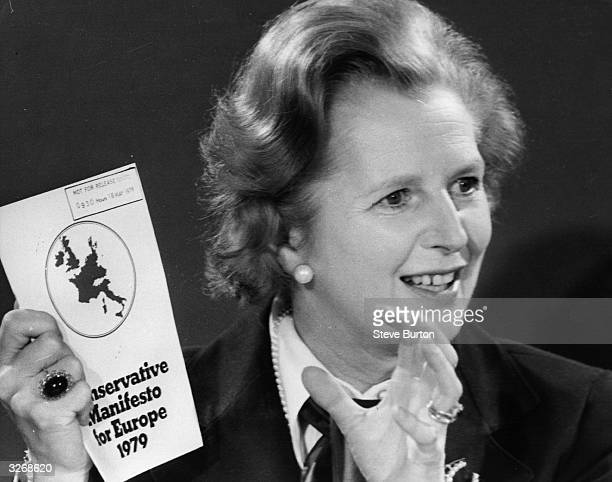 British Conservative Prime Minister Margaret Thatcher shows off her party's manifesto for the European elections 1979