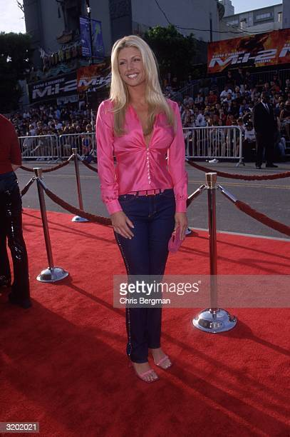 Fulllength image of American actor and Playboy Playmate Brande Roderick standing on the red carpet at the premiere of director John Woo's film...