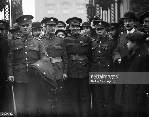 Sergeant Sanders Private Jones Sergeant Davies and Private Hill who have just been awarded the Victoria Cross at a Buckingham Palace investiture...