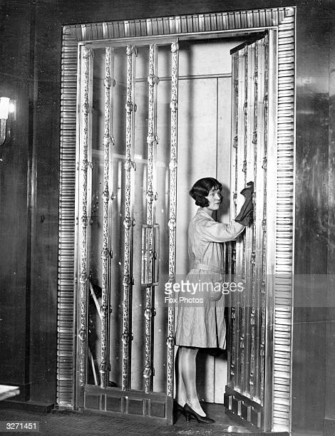 A view of glass doors designed by Rene Lalique for an exhibition of glass at the Brever Galleries Two aspects of a room designed by Lalique...