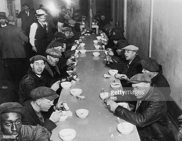 Workers enjoying the food in Al Capone's free soup kitchen for the unemployed at 935 State Street