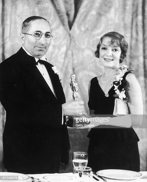 18th November 1932 Russianborn producer Louis B Mayer presents the Best Actress Oscar to American actor Helen Hayes for her role in the film 'The Sin...