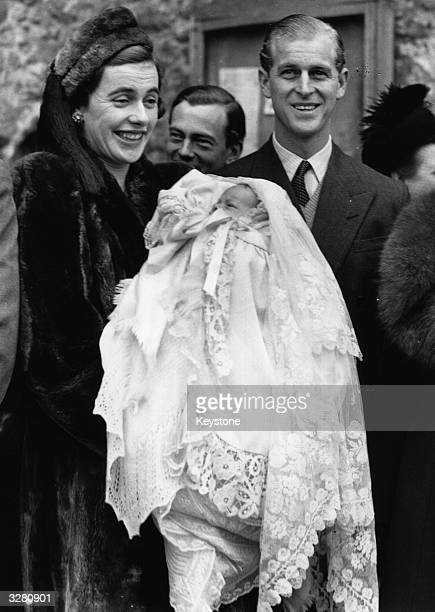 Lieutenant Mountbatten the Godfather with Lady Brabourne and her baby son after the christening