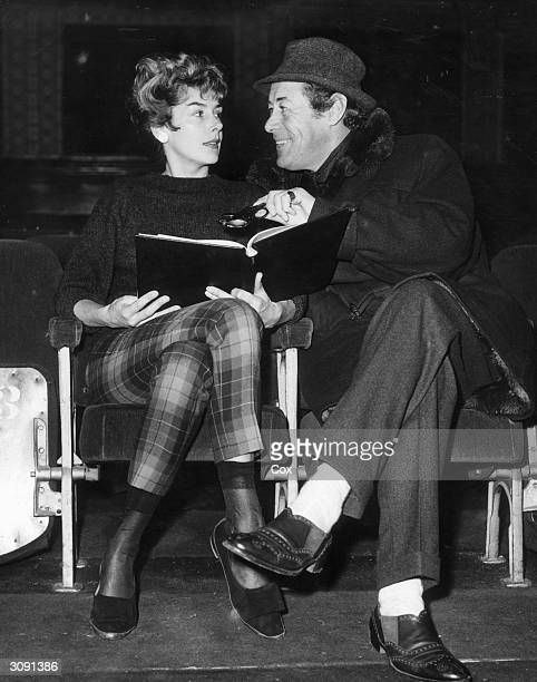 Actress Kay Kendall reading the script of the new comedy 'The Bright One' in which she is starring at the Winter Garden Theatre London under the...