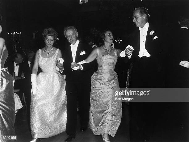 Mr and Mrs Douglas Fairbanks Jr and Mr and Mrs Arthur Rubinstein attend the Bal Polonaise, Sheraton East Hotel.