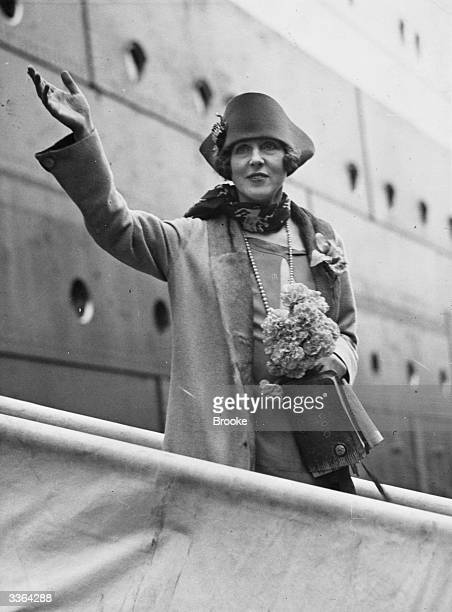 Lady Diana Cooper wife of Alfred Duff Cooper 1st Viscount of Norwich disembarks from the White Star liner HMS Homeric in England She is returning...
