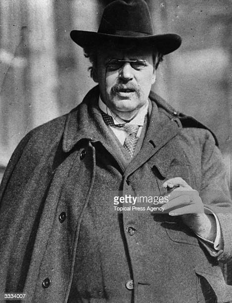 Author G K Chesterton in his familiar outfit of broadbrimmed hat cloak and pincenez