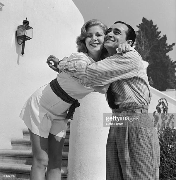 EXCLUSIVE American actor Lana Turner smiles as she hugs Jimmy Sarno of the MGM Studios publicity department at her Sunset Plaza apartment complex Los...