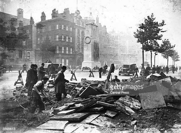 A crater in the pavement near the Cenotaph in Whitehall made by a bomb during a night raid