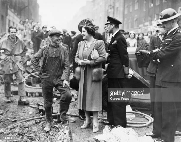 King George VI of Great Britain and Queen Elizabeth talking to a workman in a bomb damaged area of London