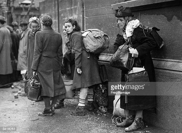 German refugees preparing to leave their home town of Aachen to escape the battle between American and German armed forces over the town They are...