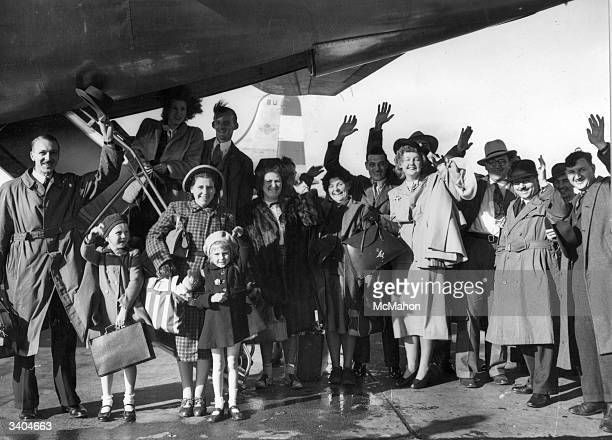 Migrant families wave goodbye as they leave Britain for new lives in Australia Leaving from London Airport they have paid the extra difference to...