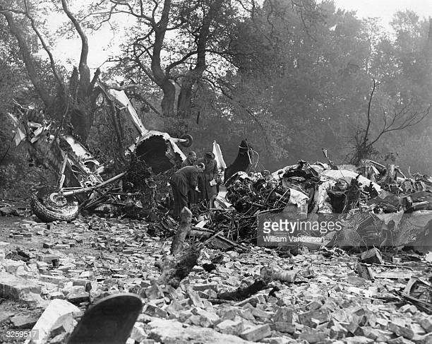 Officials from BEA inspecting the scene where twenty-eight people were killed when a BEA Dakota crashed into a hillside and caught fire at Mill Hill.