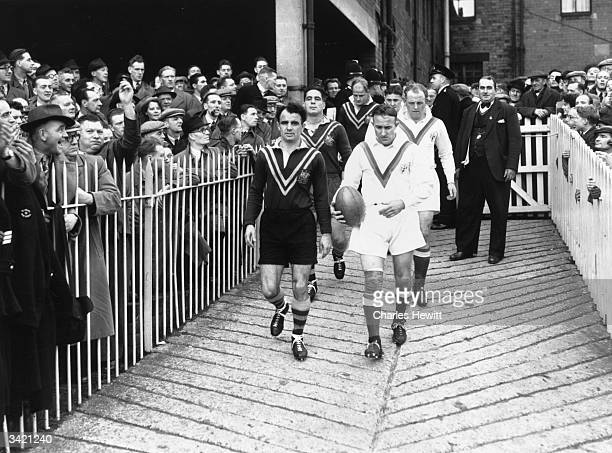 Australian captain Clive Churchill and British captain Willie Home leading their teams onto the field for their Rugby League test match Original...