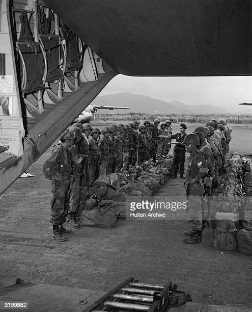 Airborne troops of the South Vietnamese Army prepare to board a C123 aircraft as part of the counterinsurgency training being conducted by the US...