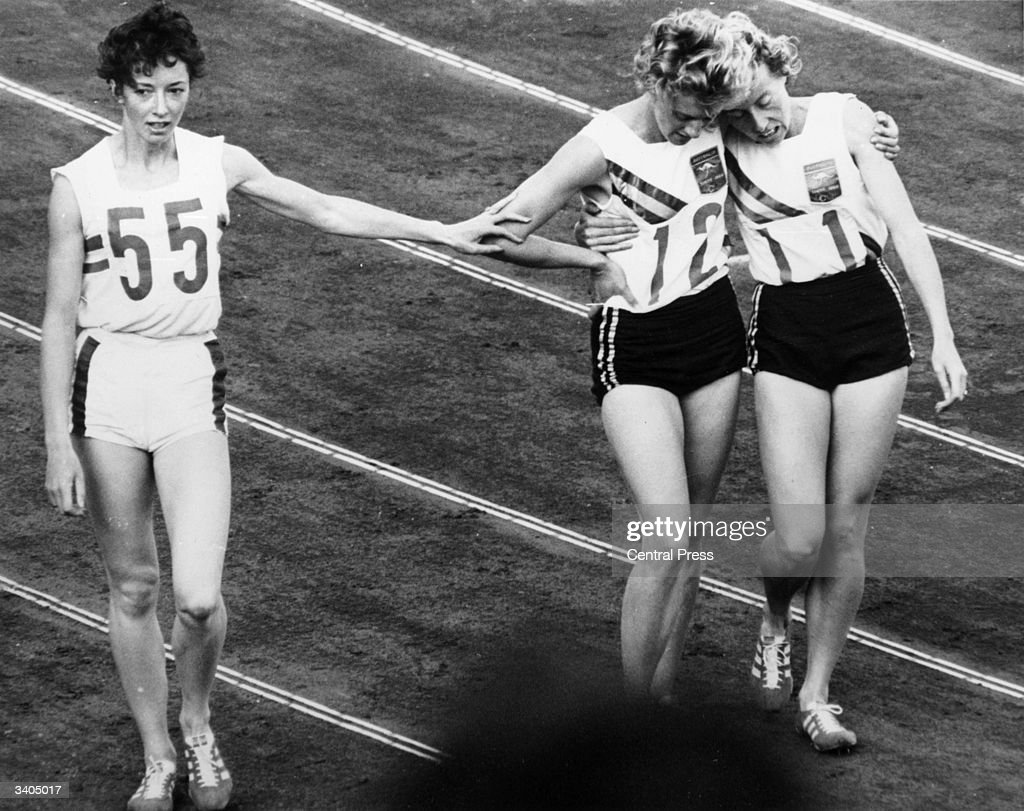 Ann Packer (left) silver medallist acknowledges defeat at the hands of Betty Cuthbert (centre), winner of the 400 metres at the Tokyo Olympic Games. Bronze medallist Judith Amooreis on the right.