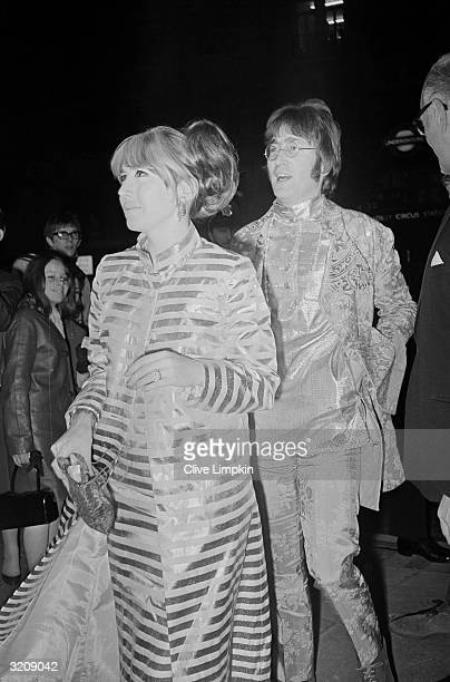 John Lennon with his first wife Cynthia at the London Pavilion Cinema to see the premiere of director Richard Lester's film 'How I Won the War' in...