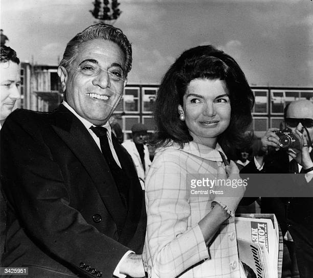 Millionaire shipping magnate Aristotle Onassis with his wife Jackie .