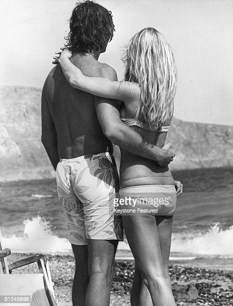 18th October 1970 French actress Brigitte Bardot relaxing in the sun with her boyfriend Patrick Gilles whilst filming 'Le Boulevard du Rhum' on...