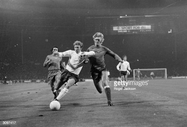 English footballer Colin Bell beats Poland's Jerzy Gorgon to the ball during a World Cup qualifying match against Poland England's draw with Poland...