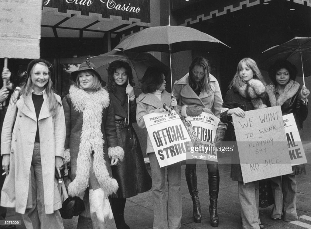 Bunny girl croupiers on picket duty outside the Playboy Club, Park Lane London.